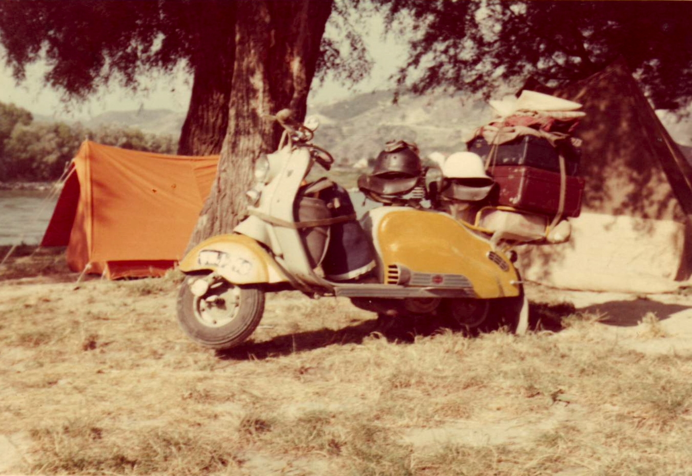 https://orvietoorbust.files.wordpress.com/2012/04/yellow-scooter-2.jpg